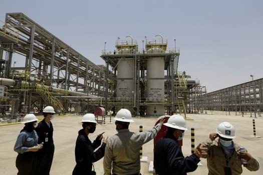 """Climate Saudi Arabia FILE - In this June 28, 2021, file photo, Saudi Aramco engineers and journalists look at the Hawiyah Natural Gas Liquids Recovery Plant in Hawiyah, in the Eastern Province of Saudi Arabia. One of the world's largest oil producers, Saudi Arabia, announced on Saturday, Oct. 23, it aims to reach """"net zero"""" greenhouse gas emissions by 2060, joining more than 100 countries in a global effort to try and curb man-made climate change. (AP Photo/Amr Nabil, File) (Amr Nabil STF)"""