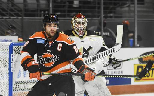 Katie Fyfe   The Journal Gazette  Komets captain Matthew Boudens watches the puck during the second period against Wheeling Nailers at Memorial Coliseum on Saturday.