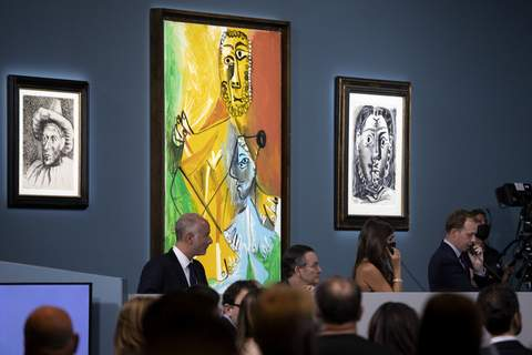 Picasso Auction Vegas Buyers and attendees mingle during an auction of Pablo Picasso's master works at the Bellagio hotel and casino Saturday, Oct. 23, 2021, in Las Vegas. (AP Photo/Ellen Schmidt) (Ellen Schmidt FRE)