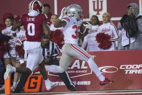 Ohio St Indiana Football Ohio State running back TreVeyon Henderson (32) scores a touchdown in front of Indiana defensive back Raheem Layne II (0) in the first quarter of an NCAA college football game in Bloomington, Ind., Saturday, Oct. 23, 2021. (AP Photo/AJ Mast) (AJ MASTFRE)
