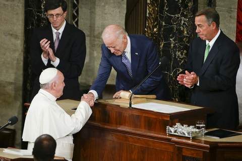 Biden Pope Associated Press Pope Francis shakes hands with then-Vice President Joe Biden in September 2015 before the pontiff's speech to a joint meeting of Congress. (Pablo Martinez MonsivaisSTF)