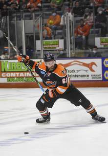 Katie Fyfe   The Journal Gazette  Komets defenseman Jameson Milam prepares to shoot the puck during the first period against Wheeling Nailers at Memorial Coliseum on Saturday.