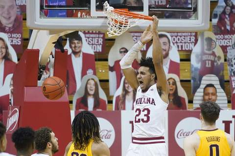 Preseason All-America Basketball FILE - Indiana's Trayce Jackson-Davis (23) dunks during the first half of an NCAA college basketball game against Minnesota in Bloomington, Ind., in this Wednesday, Feb. 17, 2021, file photo. Indiana's Trayce Jackson-Davis was selected to The Associated Press preseason All-America NCAA college basketball team, announced Monday, Oct. 25, 2021.(AP Photo/Darron Cummings, File) (Darron Cummings STF)