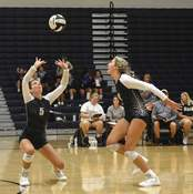 Michelle Davies| The Journal Gazette Emma Lyons of Bishop Dwenger sets the ball for Gabbie Stores this season. Lyons was named to the All-SAC first team and Stores was a second-team selection.