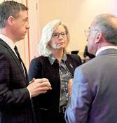 File Rep. Liz Cheney, R-Wyoming, talks with Rep. Jim Banks and Allen County Republican Chairman Steve Shine at the party's April 2019 Lincoln Day Dinner.