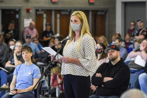 FILEAn Allen County resident speaks during the NACS school board meeting at Carroll High School.