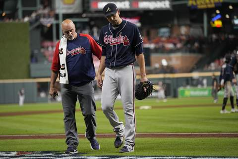 World Series Baseball Atlanta Braves starting pitcher Charlie Morton is helped off the field during the third inning of Game 1 in baseball's World Series between the Houston Astros and the Atlanta Braves Tuesday, Oct. 26, 2021, in Houston. (AP Photo/Ashley Landis) (Ashley LandisSTF)
