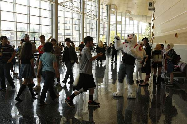 Convention attendees mingle and take pictures of each other in the main hallway at the Grand Wayne Center. (File)
