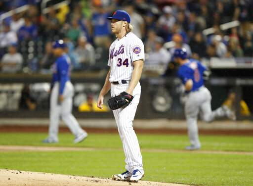 Cubs hammer Syndergaard, hold off Mets 10-7 to gain on Cards