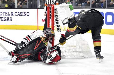 David Becker | Associated PressVegas Golden Knights right wing Reilly Smith (19) scores against Chicago Blackhawks goaltender Corey Crawford during the second period of an NHL hockey game, Tuesday, in Las Vegas.