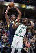 Associated Press Pacers center Myles Turner grabs a rebound over Celtics guard Kemba Walker during Wednesday's game in Indianapolis.