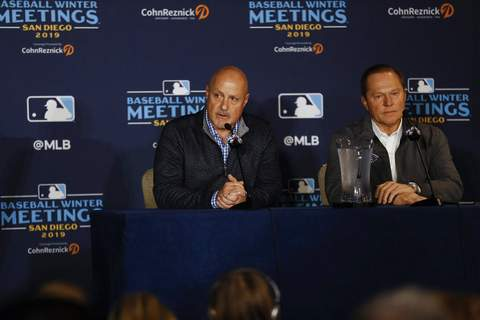 Gregory Bull | Associated PressWashington Nationals general manager Mike Rizzo, left, listens to a question alongside agent Scott Boras, right, during the Major League Baseball winter meetings Monday, in San Diego. Nationals pitcher and World Series MVP Stephen Strasburg agreed to a record $245 million, seven-year contract on Monday.