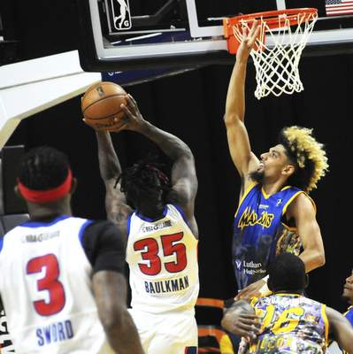 Justin A. Cohn | The Journal Gazette  The Mad Ants' Brian Bowen II, top right, attempts to block a shot by the Grand Rapids Drive's Devon Baulkman on Saturday at Memorial Coliseum.