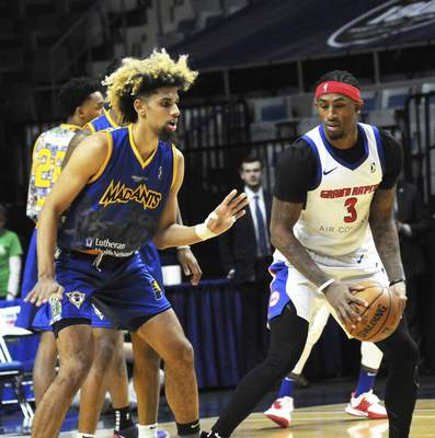 Justin A. Cohn | The Journal Gazette  Mad Ants forward Brian Bowen II, left, guards the Grand Rapids Drive's Craig Sword on Saturday night at Memorial Coliseum.