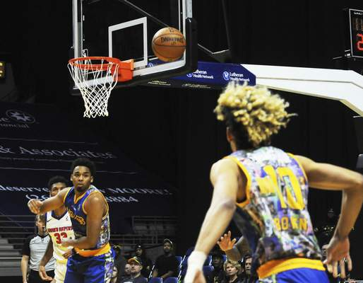 Justin A. Cohn | The Journal Gazette  The Mad Ants' Ben Moore, left, sends a pass to Brian Bowen II for a 3-point attempt Saturday at Memorial Coliseum against the Grand Rapids Drive.