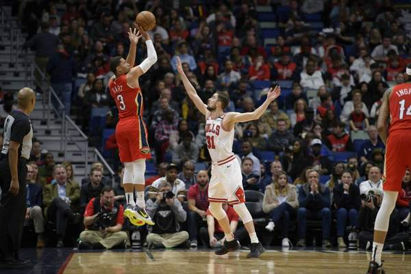 Matthew Hinton | Associated PressNew Orleans Pelicans guard Josh Hart (3) shoots a three point basket against Chicago Bulls guard Tomas Satoransky (31) in the first half of an NBA basketball game in New Orleans, Wednesday.