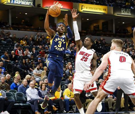 AJ Mast | Associated PressIndiana Pacers guard Aaron Holiday (3) shoots in front of Miami Heat guard Kendrick Nunn (25) during the second half of an NBA basketball game in Indianapolis, Wednesday. The Heat won 122-108.