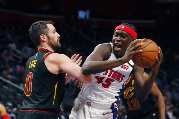 Carlos Osorio | Associated PressDetroit Pistons forward Sekou Doumbouya (45) is defended by Cleveland Cavaliers forward Kevin Love (0) during the first half of an NBA basketball game Thursday, in Detroit.