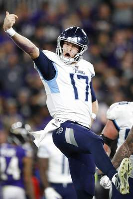 Julio Cortez | Associated PressTennessee Titans quarterback Ryan Tannehill (17) celebrates his touchdown against the Baltimore Ravens during the second half of an NFL divisional playoff football game, Saturday, in Baltimore. The Tennessee Titans won 28-12.
