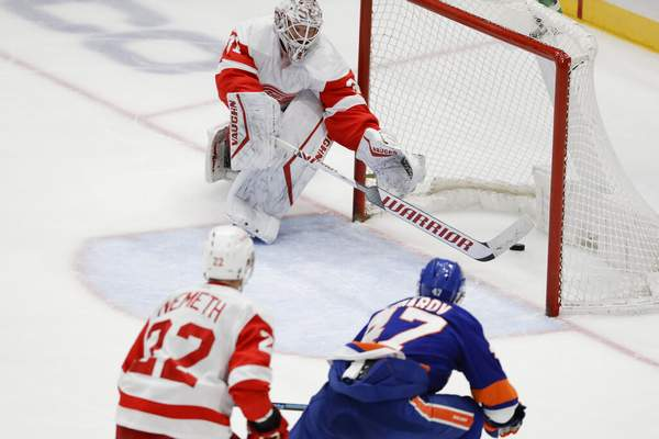 Frank Franklin II   Associated PressDetroit Red Wings goaltender Calvin Pickard, above, reaches for the puck shot by New York Islanders' Leo Komarov, right, for a goal during the third period of an NHL hockey game Tuesday, in Uniondale, N.Y. The Islanders won 8-2.