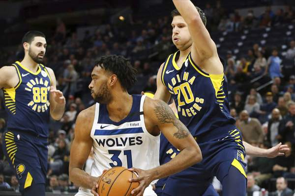 Jim Mone   Associated PressMinnesota Timberwolves' Keita Bates-Diop, center, looks for help as Indiana Pacers' Doug McDermott, right, looms over him in the first half of an NBA basketball game Wednesday, in Minneapolis.