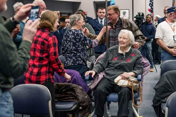 Mike Moore | The Journal Gazette  Elizabeth Lantz, a World War II veteran, receives a standing ovation  Friday while being surprised by friends and family for her 100th birthday celebration at the VA Northern Indiana Health Care System on Lake Avenue. Lantz enlisted in the U.S. Navy under the Women Accepted for Volunteer Emergency Service, or WAVES, program in November 1943.