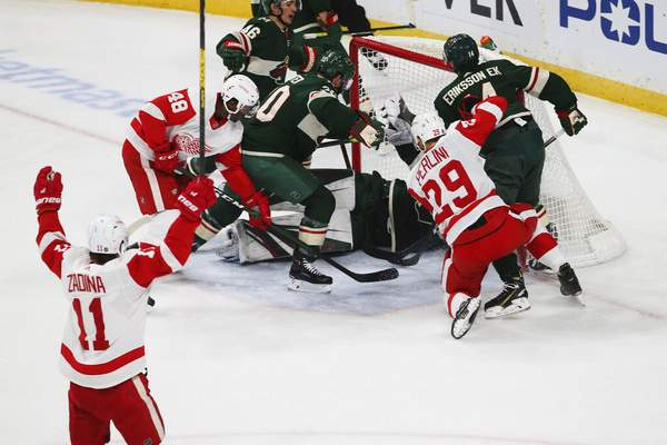 Jim Mone   Associated PressDetroit Red Wings' Filip Zadina, lower left, of Czech Republic, celebrates his power play goal off Minnesota Wild's Devan Dubnyk in the first period of an NHL hockey game Wednesday, in St. Paul, Minn. It was Zadina's second goal of the period.