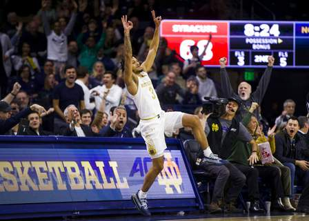Robert Franklin | Associated PressNotre Dame's Rex Pflueger (0) celebrates a 3-pointer during the second half of an NCAA college basketball game against Syracuse on Wednesday, in South Bend, Ind. Syracuse won 84-82.