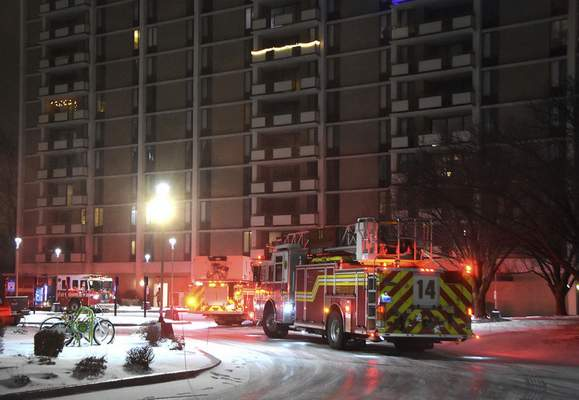 Photos by Katie Fyfe | The Journal Gazette The Fort Wayne Fire Department works the scene of a fire Wednesday night on the 11th floor  of  Three Rivers Apartments. There were no injuries, according to authorities.