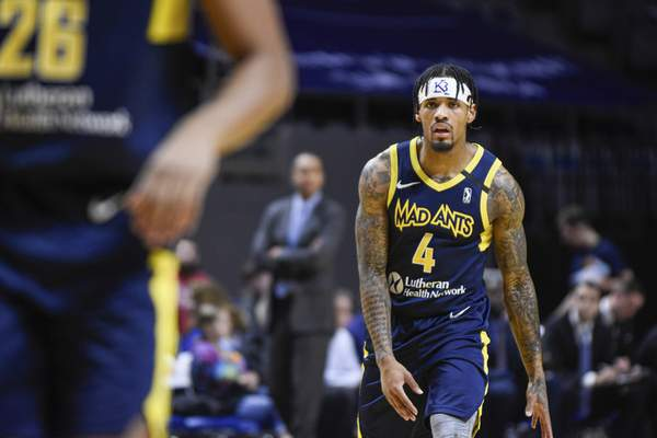 Mike Moore | The Journal Gazette  Mad Ants guard Walt Lemon Jr. scans the court in the first quarter against Raptors 905 at Memorial Coliseum on Monday.