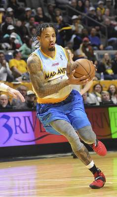 Katie Fyfe | The Journal Gazette  Mad Ants guard Walt Lemon Jr. drives to the basket during the fourth quarter against Canton Charge at Memorial Coliseum on Saturday.