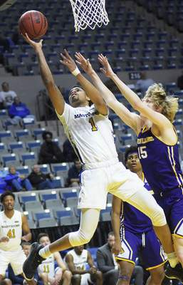 Katie Fyfe | The Journal Gazette PFW Mastodons guard Jarred Godfrey takes a shot while Western Illinois Leathernecks forward Ben Pyle tries to stop him during the second half at Memorial Coliseum on Wednesday.