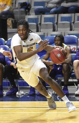 Katie Fyfe | The Journal Gazette  Purdue Fort Wayneguard Deonte Billups drives to the basket during the first half against Western Illinois at Memorial Coliseum on Wednesday.