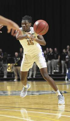 Katie Fyfe | The Journal Gazette  Purdue Fort Wayneguard Deonte Billups makes a pass during the second half against Western Illinois at Memorial Coliseum on Wednesday.