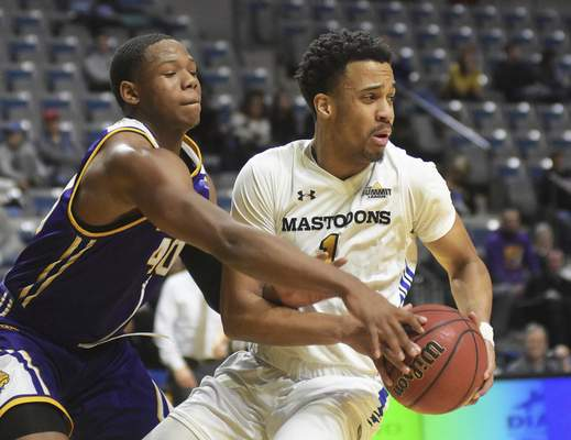Katie Fyfe | The Journal Gazette  Purdue Fort Wayneguard Jarred Godfrey looks to make a pass while Western Illinois guard C.J. Duff defends him during the second half at Memorial Coliseum.