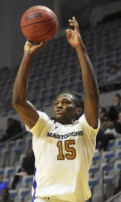 Katie Fyfe | The Journal Gazette  Purdue Fort Wayneguard Deonte Billups shoots a three pointer during the second half against Western Illinois at Memorial Coliseum on Wednesday.