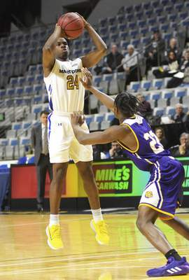 Katie Fyfe | The Journal Gazette  Purdue Fort Wayneguard Demierre Black takes a shot during the first half against Western Illinois at Memorial Coliseum on Wednesday.