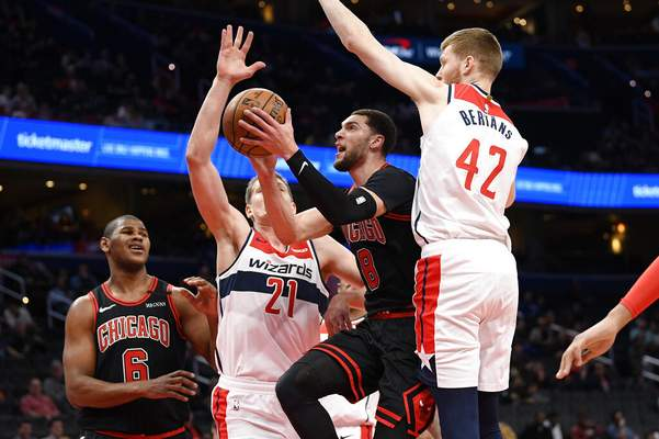 Nick Wass   Associated PressChicago Bulls guard Zach LaVine (8) goes to the basket next to Washington Wizards forward Moritz Wagner (21) and forward Davis Bertans (42) during the first half of an NBA basketball game, Tuesday, in Washington.