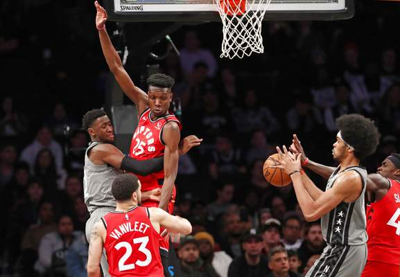 Kathy Willens | Associated PressBrooklyn Nets guard Caris LeVert, far left, tries to pass to Brooklyn Nets center Jarrett Allen, second from right, around Toronto Raptors forward Chris Boucher (25) as Raptors forward Pascal Siakam (43) defends against the pass during the second quarter of an NBA basketball game, Wednesday, in New York.