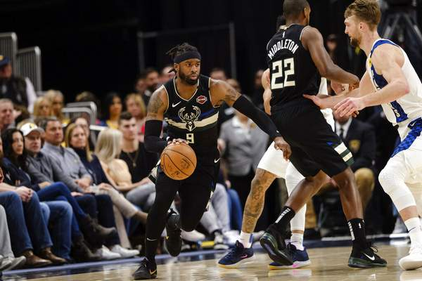 AJ Mast | Associated PressMilwaukee Bucks guard Wesley Matthews, left, drives as Indiana Pacers forward Domantas Sabonis defends during the first half of an NBA basketball game in Indianapolis, Wednesday.