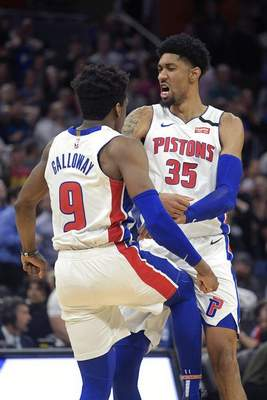Phelan M. Ebenhack | Associated PressDetroit Pistons guard Langston Galloway (9) and forward Christian Wood (35) celebrate after Galloway made a three-point basket to send the game into overtime during the second half of an NBA basketball game Wednesday, Fla.