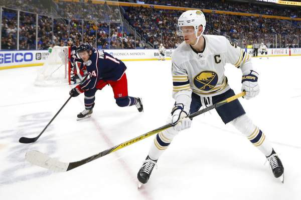 Jeffrey T. Barnes | Associated PressBuffalo Sabres forward Jack Eichel (9) and Columbus Blue Jackets forward Gustav Nyquist (14) skate to the corner during the first period of an NHL hockey game Thursday, in Buffalo, N.Y.
