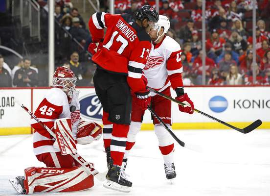 Kathy Willens   Associated PressNew Jersey Devils right wing Wayne Simmonds (17) leaps to allow the puck a path to the goal as Detroit Red Wings goaltender Jonathan Bernier (45) makes a save against his chest during the second period of an NHL hockey game, Thursday, in Newark, N.J.