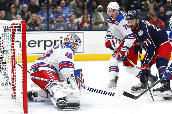 Jay LaPrete | Associated PressNew York Rangers' Alexandar Georgiev, left, makes a save as Brady Skjei, center, and Columbus Blue Jackets' Nick Foligno watch the puck during the second period of an NHL hockey game Friday, in Columbus, Ohio.