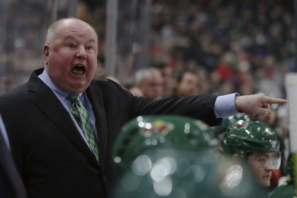 Minnesota Wild's head coach Bruce Boudreau shouts after a penalty call in the second period of an NHL hockey game against the Vancouver Canucks, Sunday, Jan. 12, 2020, in St. Paul, Minn. (AP Photo/Stacy Bengs)