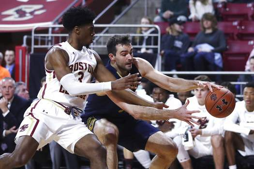 Charles Krupa | Associated PressBoston College guard Jared Hamilton (3) tries to stop Notre Dame forward John Mooney, right, on a drive to the basket during the first half of an NCAA men's college basketball game in Boston, Wednesday.