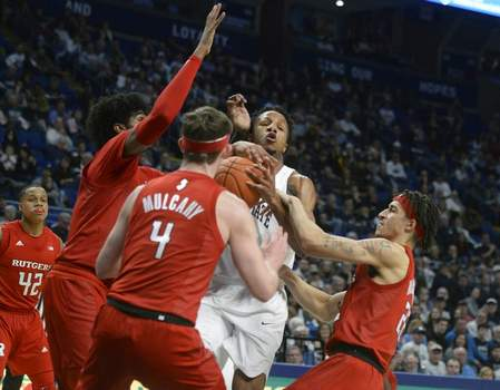 Gary M. Baranec | Associated PressPenn State's Lamar Stevens (11) is fouled by Rutgers Ron Harper Jr., right, and Paul Mulcahy, center, during the first half of an NCAA college basketball game, Wednesday, in State College, Pa.