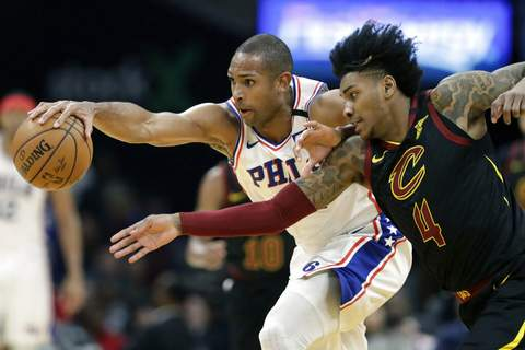 Tony Dejak | Associated PressPhiladelphia 76ers' Al Horford, left, and Cleveland Cavaliers' Kevin Porter Jr. battle for a loose ball in the first half of an NBA basketball game, Wednesday, in Cleveland.