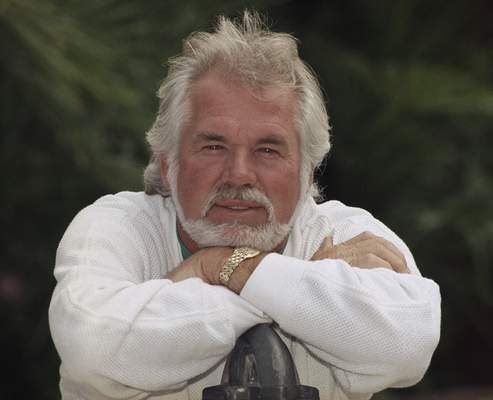 Associated Press Famed musician Kenny Rogers, pictured in 1989,  has died at 81. A representative says Rogers died at his Georgia home Friday.