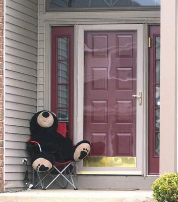 Photos by Michelle Davies | The Journal Gazette Homes in The Falls and Laurel Ridge neighborhoods have placed teddy bears in front windows and on porches to provide a scavenger hunt for neighborhood children.